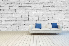 White Couch with Seamless Stone Pattern Wall Royalty Free Stock Images