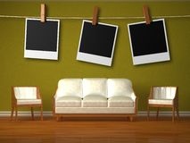 White couch and two chairs and hanging frames Stock Photos