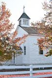 White Country Church in Fall royalty free stock photography