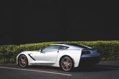 White Coupe Car Near Green Grass Royalty Free Stock Images