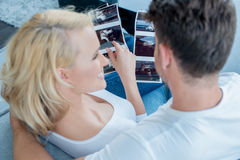 White Couple on Couch Looking Pictures Together Stock Images