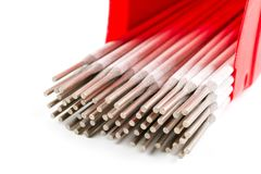 White Covered Arc Welding electrode. Close up White Covered Arc Welding electrode for Steel in red plastic box isolated on white background Stock Photography