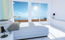 White and cozy minimal bedroom interior with sea view in summer Stock Photography