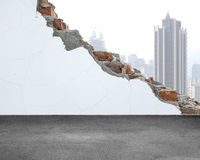 White crack bricks wall with city building background and concre. White crack bricks wall with city building background and dirty concrete floor Stock Images