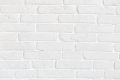 White cracked brick wall Stock Images