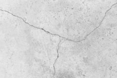 White Cracked concrete wall surface of rough texture background stock photography