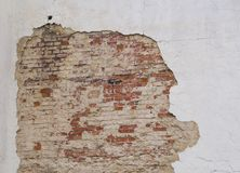 White cracked wall with peeling plaster with red brick grunge vi. Ntage background Stock Photo