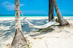 White cradle on the beach. The white cradle on the beach with beautiful view of blue aqua sea water and sky stock images
