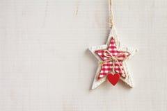 White craft star Christmas decoration hanging on background horizontal. White craft star Christmas decoration hanging on white wooden background horizontal royalty free stock images