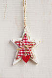 White craft star Christmas decoration hanging on white backgroun Royalty Free Stock Images
