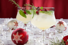 White Cranberry Spritzer. Close-up of white cranberry spritzer cocktail on holiday table with Christmas ornaments. Holiday cocktails series Royalty Free Stock Photos