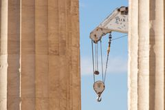 White crane between two marble Parthenon columns Stock Photos