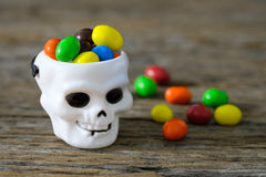 White cranium. Candy colors contained in the tank white cranium skull royalty free stock image