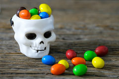 White cranium. Candy colors contained in the tank white cranium skull stock photos