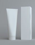 White cream bottle and tall paper box Stock Image