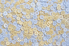 White and cream buttons (clasper) Stock Photos