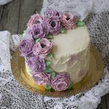 White cream cake decorated with buttercream flowers royalty free stock image