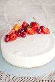 White Cream Icing Cake with Fruits Stock Photo