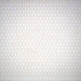 White cream plastic surface with a repeating pattern. Stock Image