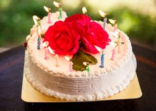 White creamy delicious cake with candles Stock Images