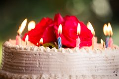 White creamy delicious cake with candles Royalty Free Stock Image