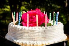 White creamy delicious cake with candles closeup Stock Photos