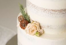 Closeup picture about a detail of white wedding cake with ornaments stock images