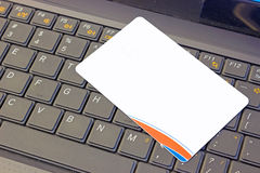 What is the purpose of a credit card. White credit card on a laptop,photography Royalty Free Stock Images