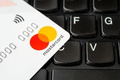 Free White Credit Or Debit Card Mastercard For Cashless Payments With Pay Pass On A Black Laptop Keyboard Stock Photo - 165196480