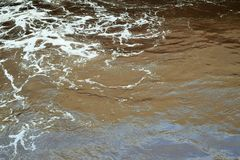 White crest waves on a brown river Royalty Free Stock Image