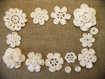 White crochet flowers Stock Images