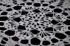 White Crochet Lace on black background. Floral Crochet on black background Royalty Free Stock Images