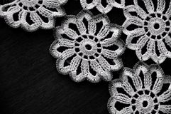 White Crochet Lace on black background. Floral Crochet on black background Royalty Free Stock Photo