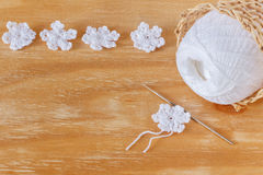 White crochet snowflakes for Christmas decoration on wooden table Stock Photos