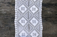 White Crochet Tablecloth. On the black desk Stock Image