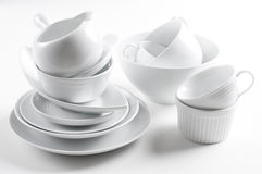 White crockery and kitchen utensils. A lot of white crockery and kitchen utensils on white background Stock Photos