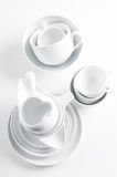 White crockery and kitchen utensils Royalty Free Stock Image