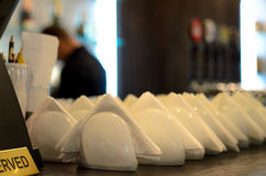 White crockery and napkins on a bar counter Royalty Free Stock Photo