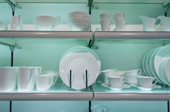 White crockery on shelves Royalty Free Stock Photo
