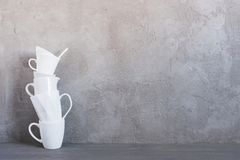 White crockery on the table against the textured grey wall. Background with copy space royalty free stock photos