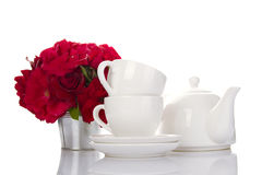 White crockery for tea and a bouquet of roses Royalty Free Stock Photos