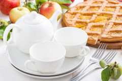 White crockery for the tea party and apple pie Royalty Free Stock Photo