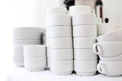 White crockery on a white , a restaurant Stock Photos