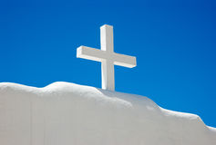 White cross. White wooden cross on top of white adobe wall Royalty Free Stock Images