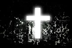 White Cross on Abstract Black. White glowing cross with abstract black background on back. White is a symbol of purity. So is black a symbol of darkness and sin Stock Photography