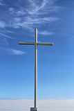 A white cross. Against a blue wispy sky Stock Images