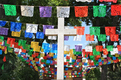 White cross with colorful flags, Mexico. Church entrance with a big white cross and colorful flags in Mexico City Royalty Free Stock Photo