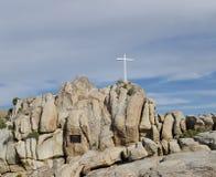 White Cross in Desert Landscape. White Cross on Rocks Honoring the Dead in Wilderness Landscape royalty free stock images