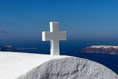 White cross in front of blue sky Royalty Free Stock Photography