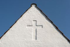 White cross on gable sky blue Stock Image